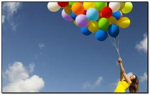 Girl Flying With Baloon