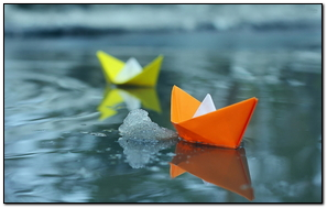 Paper Boats On Icey Lake.