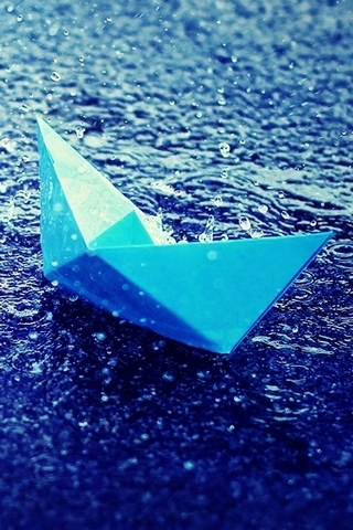 Blue Paper Boat In Rain