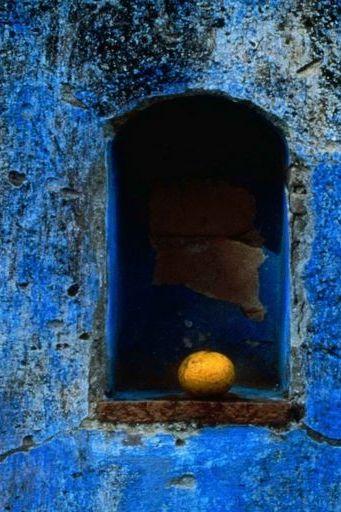 Orange In Blue Wall