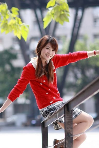 Pretty Asian Girl In Red Jumper