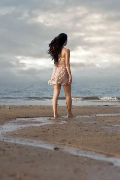 Girl-Walking-On-Beach-768x1280