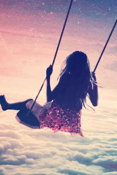 Girl On Swing Above Cloudy Sky