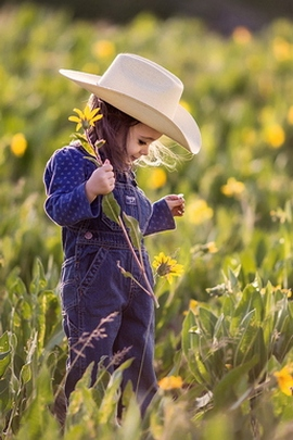Lovely Little Girl And Flower