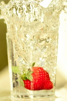 Strawberry Falling In Glass Of Water