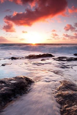 Waves Splashing On The Rock