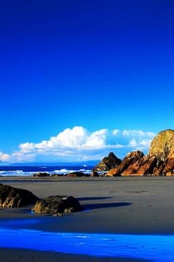 Wonderful Blue Water And Big Rock
