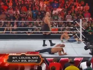 John Cena and The Rock attacking Big Show