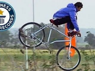 Longest bicycle stoppie (feet on handlebars)