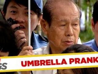 Uninvited Strangers Share Same Umbrella