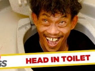 Head Pops Out of Toilet