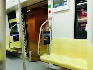 Chinese man delays subway with a cardboard box