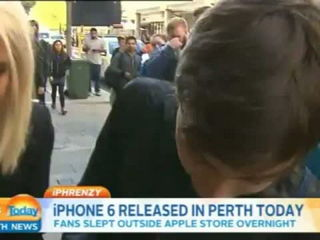 First person to buy an iPhone 6 in Perth immediately DROPS IT!