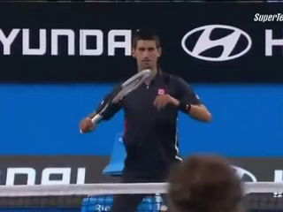 Ana Ivanovic throwing a ball at Novak Djokovic to stop him dancing