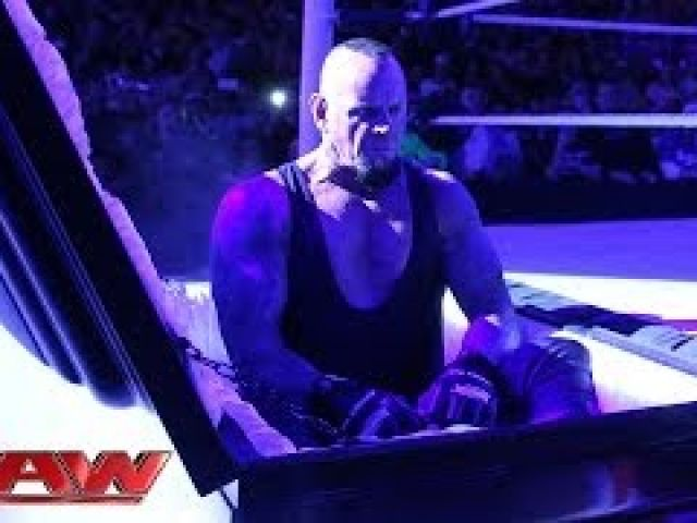 WWE Undertaker rises from a coffin to attack Brock Lesnar