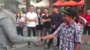 Guy gets punched by street performer